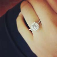 Engagement rings on dark fingers